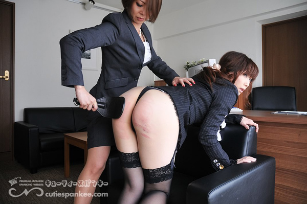 Female employee gets spanked for wearing a skirt during her retraining