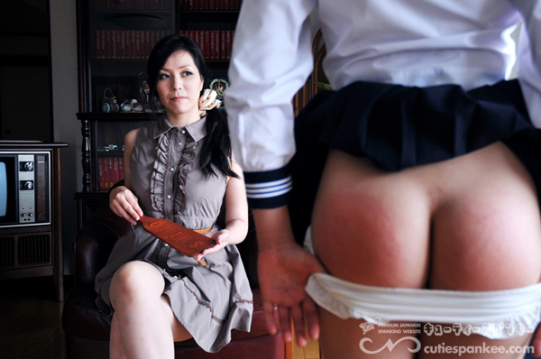 Schoolgirl lowers her white panties for mom's wooden paddle