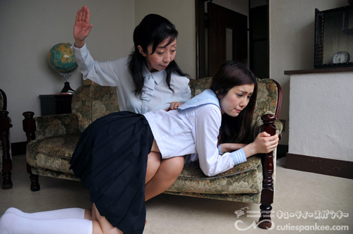 Mrs Kanda starts off by spanking the Japanese girl OTK over her skirt