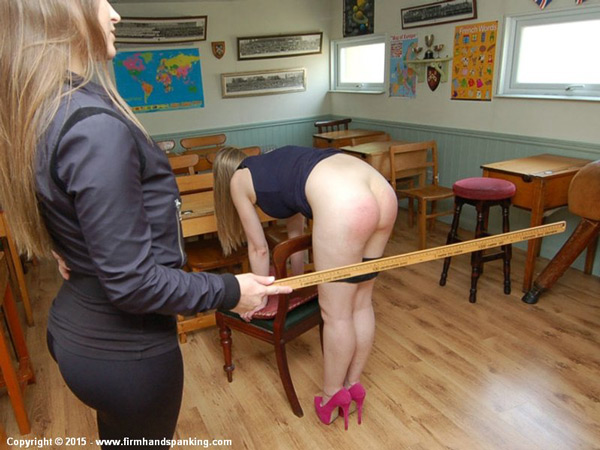 Dani Daniels spanks Belinda's bare bottom with the yard stick