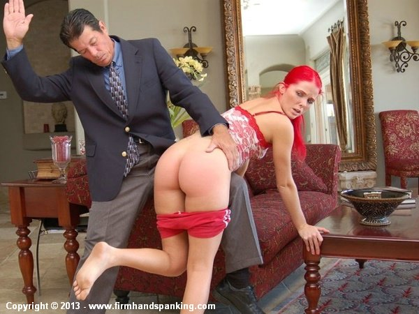 Alison Miller gets spanked over Eric's knee on the arm of the couch