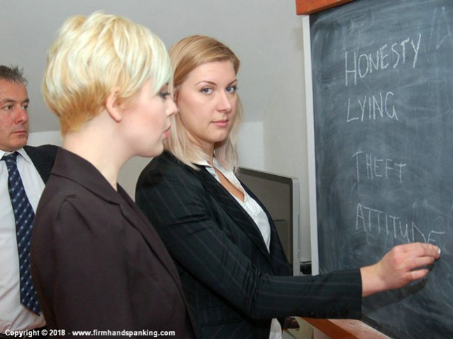 Belinda Lawson and Helen Stephens write their misdemeanors on the chalkboard at the Reform Academy