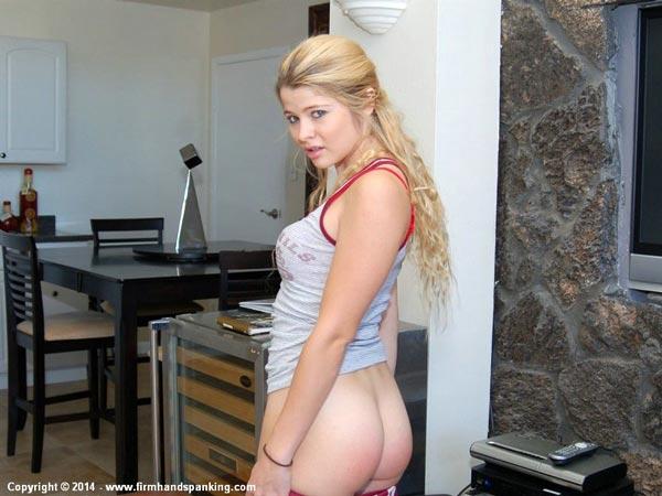 Kylee Anders examines her well-spanked bottom