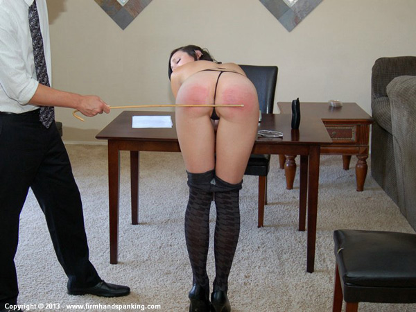 Naughty secretary Stacy Stockton caned on bare bottom for stripping in office