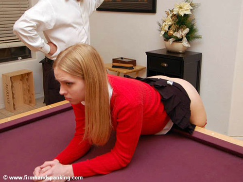 Chloe Elise bends over the pool table for her caning