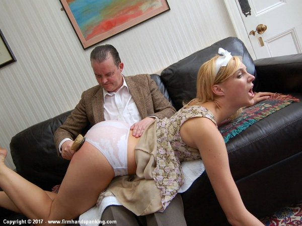 Amelia gets a hard paddling from the wooden hairbrush