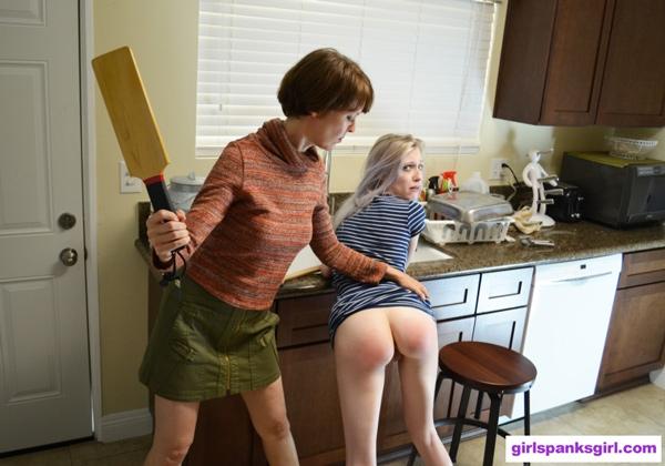 Violet October bends over in the kitchen for a paddling