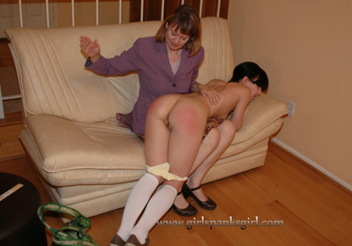 Elise gets spanked by Clare completely nude over the knee