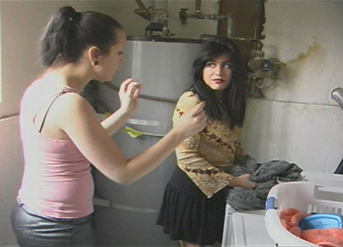 Nikki confronts her neighbor, Lotus, about hogging the laundry room