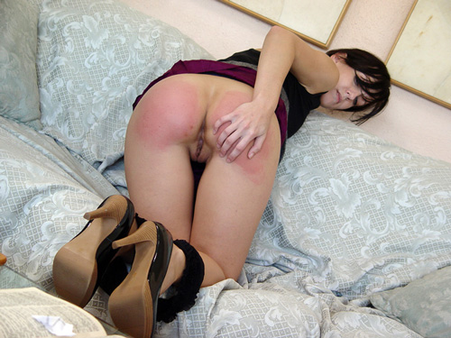 Elise rubs her very sore and rosy bottom
