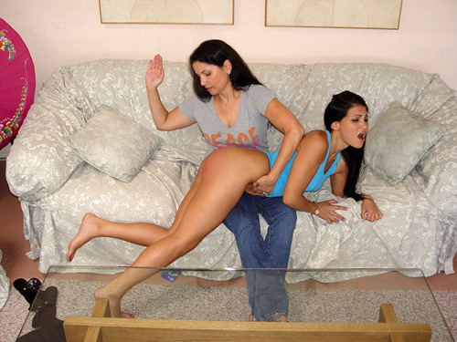 With her panties removed Chelsea gives Jade a hard OTK hand spanking