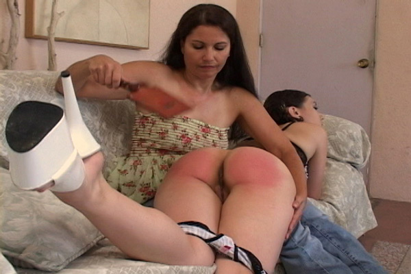Chelsea Pfeiffer spanks Sinn Sage's bare bottom with a leather paddle OTK