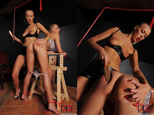 Teena Lipodino spanks Danielle with a wooden paddle