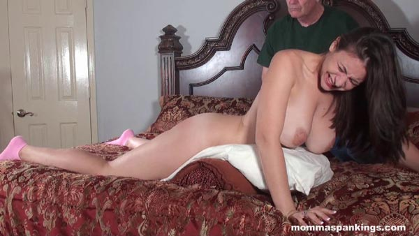 Busty Sarah contorts from the pain of the leather strap