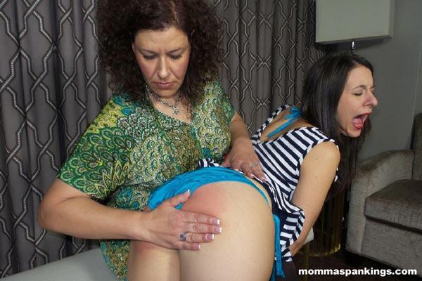 Miss Chris gives Sarah a hard OTK hand spanking