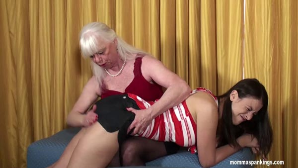 Sarah is spanked OTK over her tiny shorts