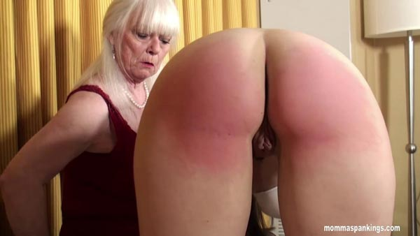A close-up of Sarah's spanked bare bottom as she stands up