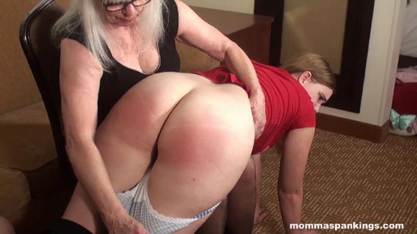 Momma prepares the second big bottom by pulling down the panties over her knee