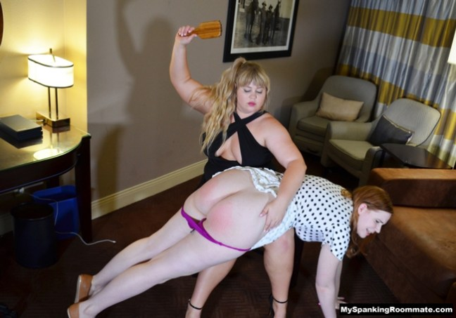 Christy Cutie spanks Alex Reynolds' bare bottom OTK with a wooden hairbrush