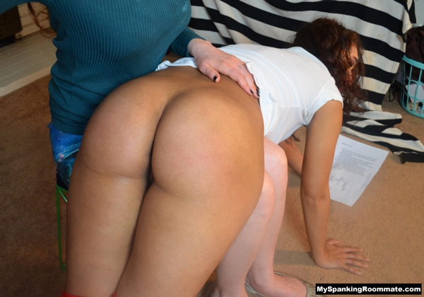 Kitty Catherine's nice round booty gets soundly spanked over the knee