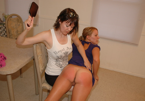Amber's lovely bare bottom gets very red from the hairbrush spanking