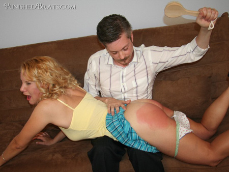 Amber Pixie Wells goes OTK for a hard hairbrush spanking