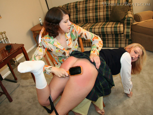 Naughty Charlie Skye gets spanked by her sister, Beverly Bacci