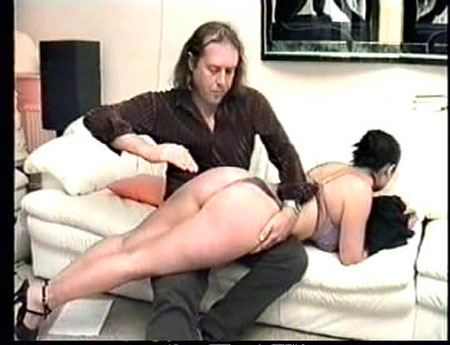 Brunette with a perfect body spanked OTK in this movie