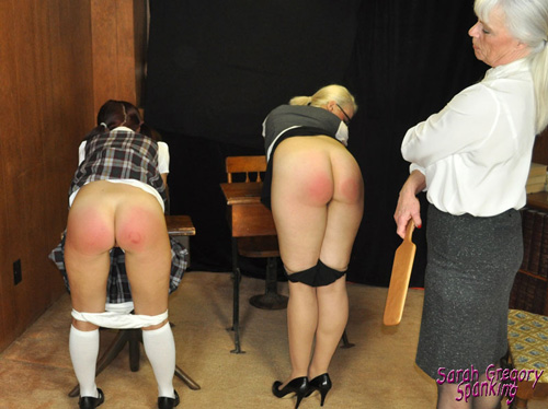 Principal Dana Specht inspects the two well-spanked bottoms at the front of class