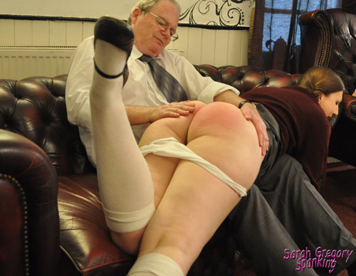 Pandora's regulation school knickers are pulled down and she is spanked on her bare bottom