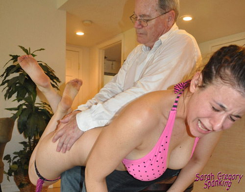 Inside the house Sarah Gregory gets her wet, clammy bottom spanked hard by her daddy