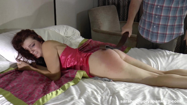 Syrena gets a very painful strapping on the bed with a leather belt