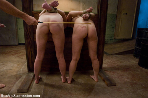 Lilla Katt and Seda get caned in the pillories