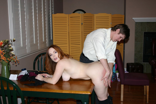 Kyle rubs lotion in Summer Hart's spanked bottom as she bends over naked