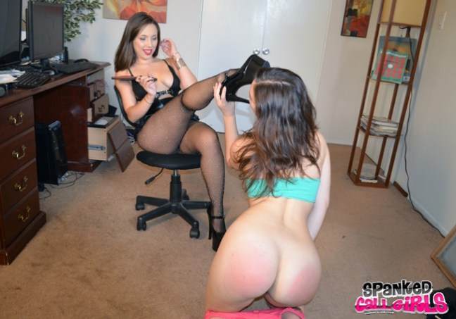 With her bare bottom still red from the spanking, Juliette March is made to kiss Jenna Sativa's high heels