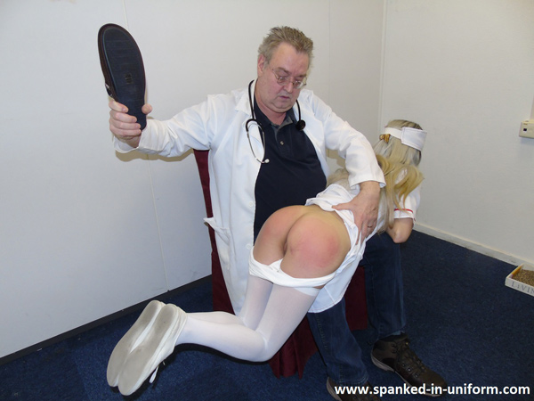 Nurse Sydney's white panties are pulled down and she is slippered OTK on her bare bottom