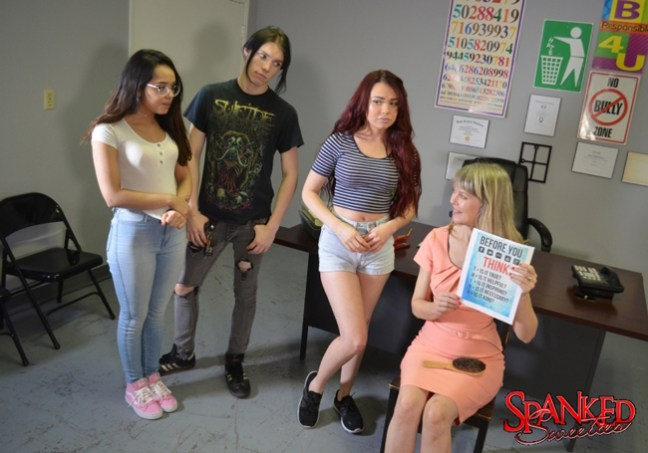 Sabina Rouge and Esperanze Del Horno listen to Clare Fonda after their spankings