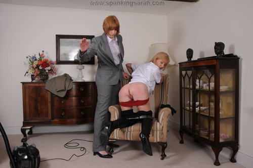 Lady Suzie is bent over a chair and hand-spanked by sarah on the bare bottom