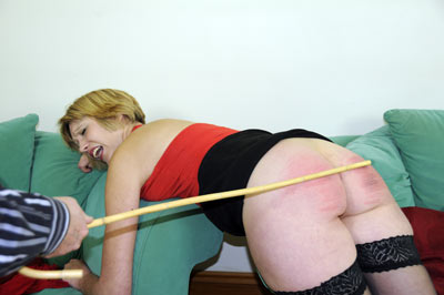 English amateur housewife Sarah bends over the sofa for her caning