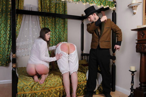 Both ladies bend over the bed for their period-style punishment