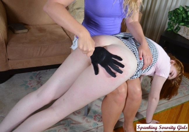 Cherry spanked by Mia Vallis OTK with a leather paddle on her bare bottom