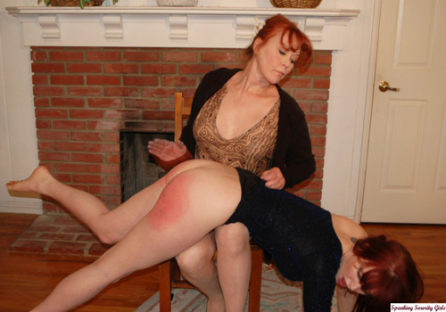 Pretty model Veronica Ricci gets spanked OTK on the bare by her mom, Mistress Crystal