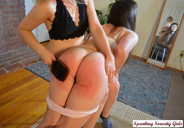 Elori Stix's curvy bare bottom gets spanked hard with the wooden hairbrush