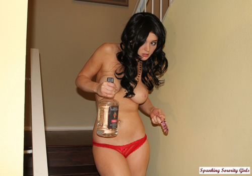 Veronica Ricci comes down the stairs almost naked holding a bottle of vodka and a dildo