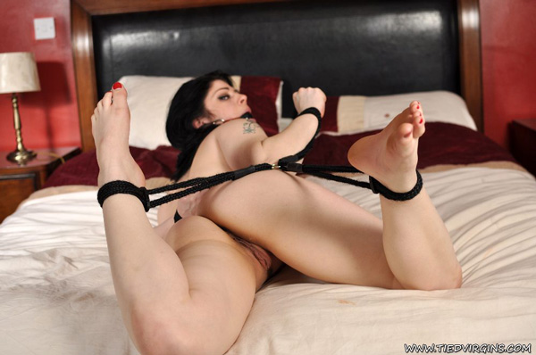 Lucia Love gets tied in bondage on the bed