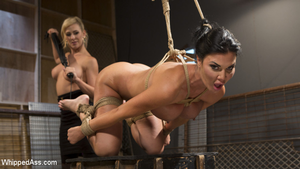 Cherie Deville whips Jasmine Jae's ass naked and tied up in bondage from behind