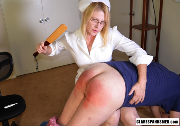 Miss Cassie paddles a man in Femdom spanking