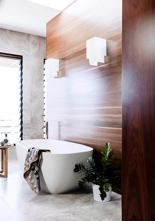 A touch of timber in the bathroom creates a zen-like feel