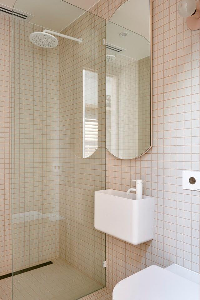 Apricot tile grout gives this bathroom a unique edge Photo Nikole Ramsay