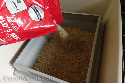 pouring fresh World's Best Cat Litter into litter box